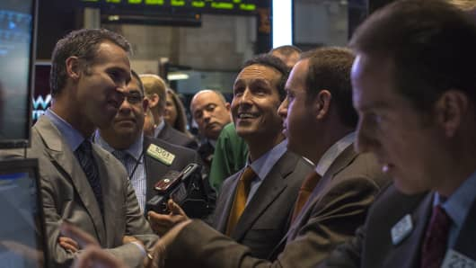 Veeva Systems Founder and CEO Peter Gassner looks up to the price of his company's stock on the floor of the New York Stock Exchange
