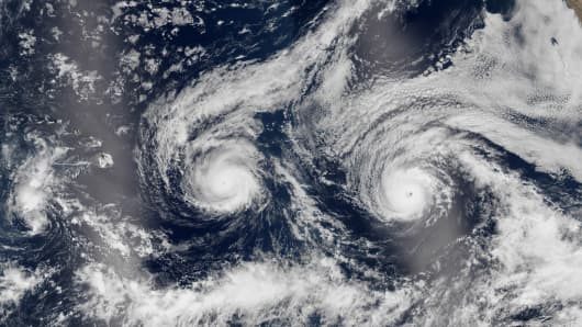 This satellite image taken Monday, Aug. 29, 2016 and released by NASA shows Hurricane Madeline, left, and Hurricane Lester over the Pacific Ocean in a composite built from two overpasses by the Visible Infrared Imaging Radiometer Suite on the Suomi NPP satellite.
