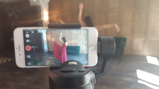 DJI's Osmo Mobile can track moving objects to ensure a smooth shot. The Chinese drone maker showed this off with a dancer during a demo at the IFA consumer electronics show in Berlin.