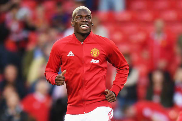 Paul Pogba of Manchester United warms up prior to the Premier League match between Manchester United and Southampton at Old Trafford on August 19, 2016 in Manchester, England.