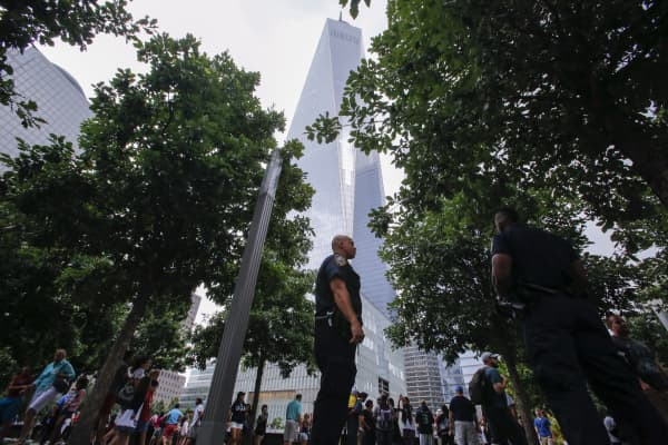 Police patrol the grounds of One World Trade