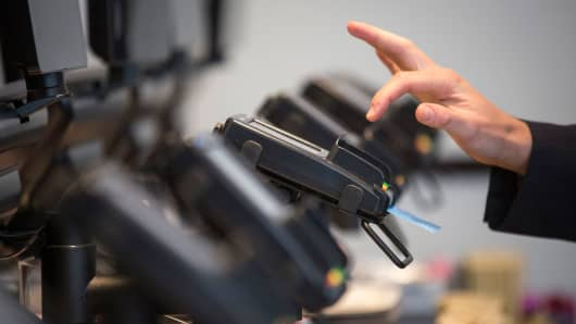 A customer enters their pin number as they make a chip and pin payment via a Verifone Systems credit card payment device.