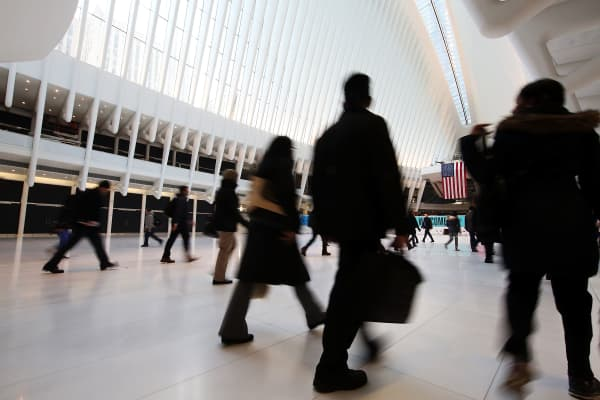 Commuters walk through the Oculus in World Trade Center Transportation Hub