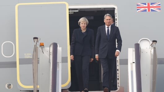 UK Prime Minister Theresa May and Finance Minister Philip Hammond arrive at Hangzhou Xiaoshan International Airport in China for the G-20 meeting on September 4, 2016.