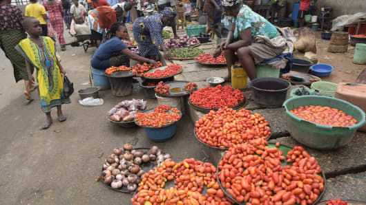 Vendors display tomatoes and pepper at Mile 12 market in Lagos, on June 21, 2016.