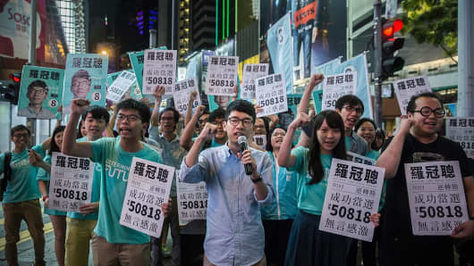 Nathan Law (center) speaks at a rally with 19-year-old student activist Joshua Wong (center left) and supporters in Causeway bay following Nathan Law's win in the Legislative Council election in Hong Kong on September 5, 2016. A new generation of young Hong Kong politicians advocating a break from Beijing looked set to become lawmakers for the first time on September 5 in the biggest poll since mass pro-democracy rallies in 2014.