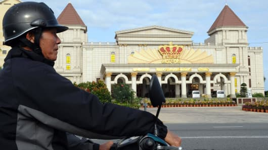 A motorbike taxi driver waiting for clients in front of the Crown Casino run by Silver Shores International Resort in the Vietnamese central coastal city of Danang