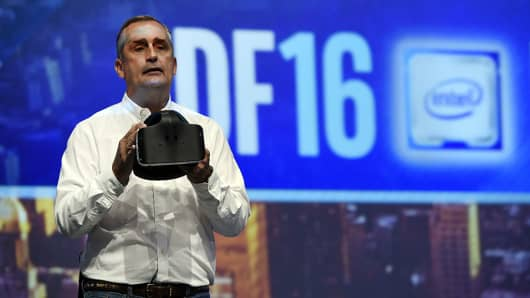 Brian Krzanich, chief executive officer of Intel Corp., displays a Project Alloy virtual reality (VR) headset during a keynote speech at the 2016 Intel Developers Forum (IDF) in San Francisco, California, U.S., on Tuesday, Aug. 16, 2016.
