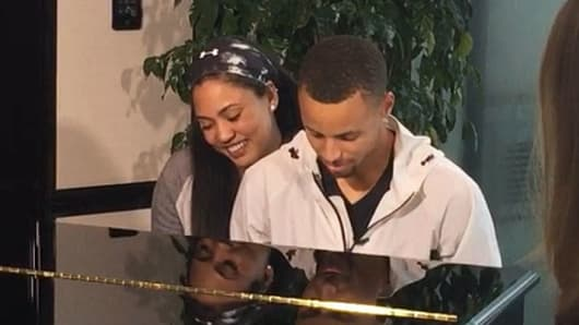 NBA star Steph Curry and his wife, Ayesha, at the piano in China