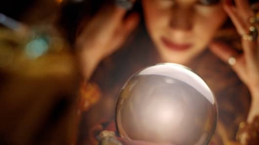 Fortune Teller looking at crystal ball, predictions, betting