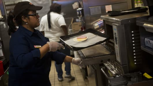 An employee prepares a breakfast sandwich for a customer at a Dunkin Donuts Inc. restaurant in New York.