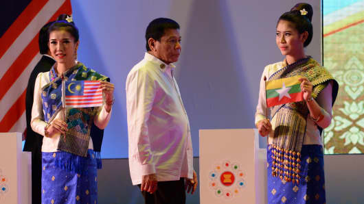 Philippine President Rodrigo Duterte walks up the stage for the opening of the ASEAN Summit in Vientiane on September 6, 2016.