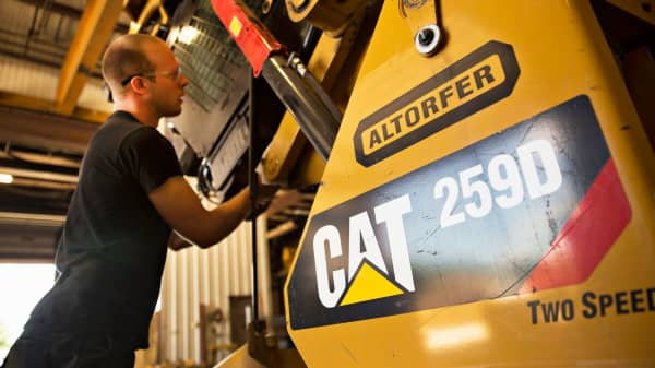 A technician works on a Caterpillar 259D compact track loader at the Altorfer Cat dealership in East Peoria, Illinois.