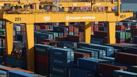 Containers are stacked at the Hanjin Shipping Co. Busan New Port terminal in Busan, South Korea