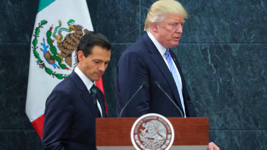 Mexican President Enrique Pena Nieto walks with then-presidential candidate Donald Trump after a meeting on Aug. 31, 2016, in Mexico City.