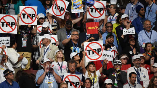 Protesters state their position on the Trans-Pacific Partnership, during the first day of the Democratic National Convention in Philadelphia on Monday, July 25, 2016