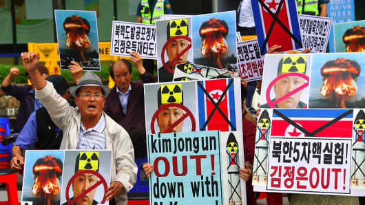 ollection: AFP South Korean conservative activists hold placards showing the portrait of North Korean leader Kim Jong-Un during a protest denouncing North Korea's nuclear test in Seoul on September 10, 2016.