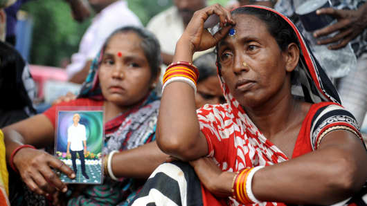 Relatives of missing workers at the Tampaco Foils packaging factory at Tongi in Gazipur.