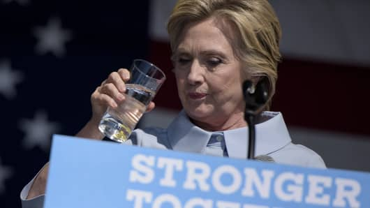 Democratic presidential nominee Hillary Clinton sips water during a Labor Day rally September 5, 2016 in Cleveland, Ohio.