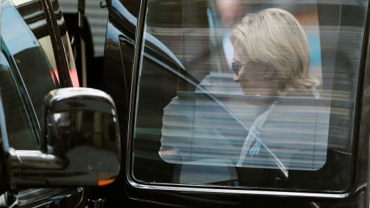 Hillary Clinton gets in a car while leaving her daughter's apartment building on September 11, 2016, in New York.