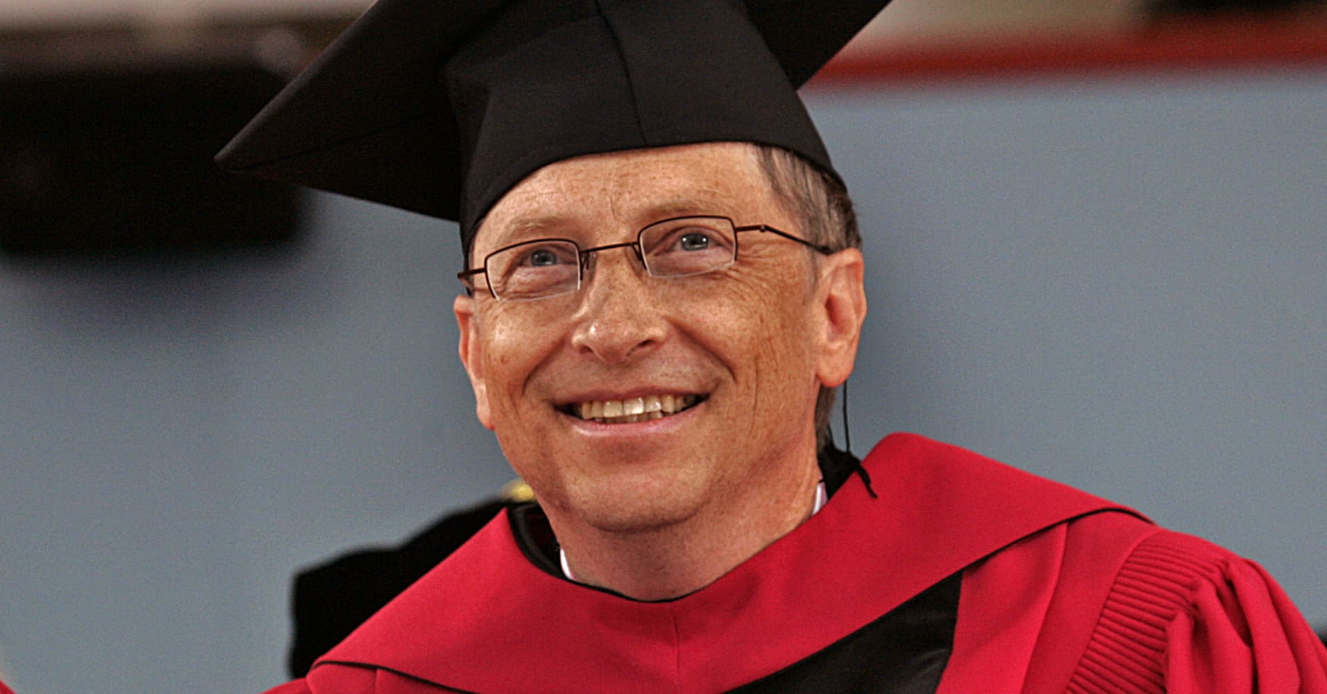At Harvard University Bill Gates grins from ear to ear who looks over his honorary degree.