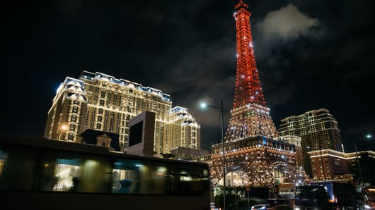 The Eiffel Tower attraction, a half-size replica of the Eiffel Tower in Paris, stands illuminated at the Parisian Macao casino resort, operated by Sands China, a unit of Las Vegas Sands Corp, in Macau.