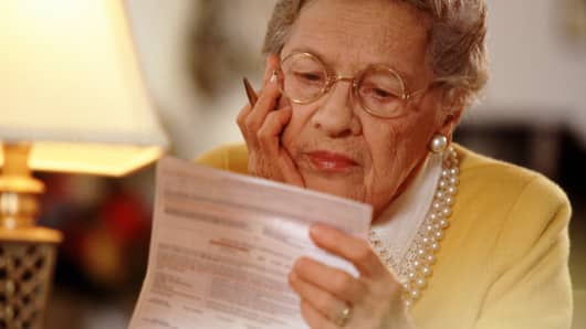 Elderly woman reviewing documents