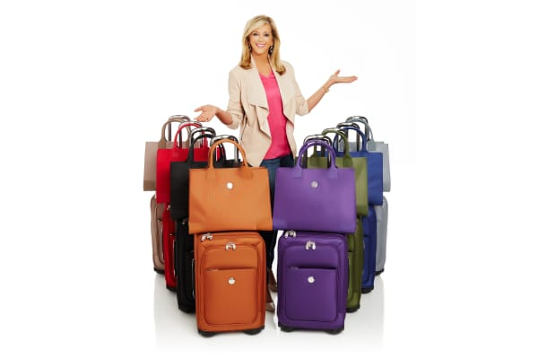 Joy Mangano with a recent invention, durable luggage made of bulletproof material and car-bumper rubber.