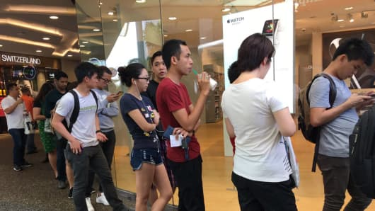 Buyers queue outside an Apple resales store in Tampines, Singapore, on September 16 to buy the just-released iPhone 7.