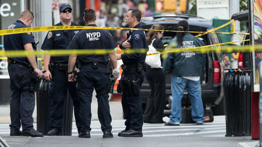 Members of the New York City Police Department and other law enforcement officials work at the scene of Saturday night's explosion in the Chelsea neighborhood of Manhattan.