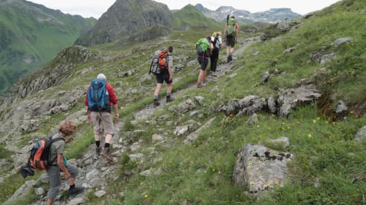 Visitors hike up towards the Tilisunahuette mountain hut in the Raetikon mountain range on August 2, 2016 near Tschagguns, Austria.