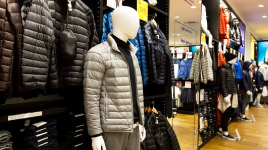 Coats on display at a Uniqlo store in Singapore on Friday, Sept. 16.