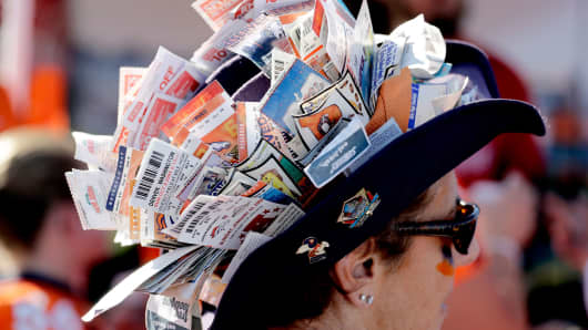 A Denver Broncos fan wears used game tickets on her hat prior to a game against the Carolina Panthers, Sept. 8, 2016, in Denver.