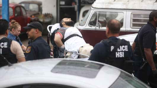 Suspect Ahmad Rahami shot in Linden, NJ and in police custody is taken to hospital on Sept. 19, 2016.