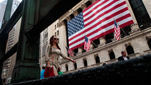 People walk past the New York Stock Exchange.