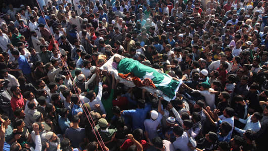 Kashmiris carry the body of 11 year-old Nasir Shafi in Harwan on the outskirts of Srinagar, Indian-controlled Kashmir, on September 17, 2016. Nasir was killed when Indian police fired pellets on him during clashes in Harwan, local residents said.