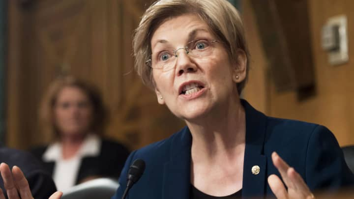Senator Elizabeth Warren, Democrat of Massachusetts, questions John Stumpf, chairman and CEO of Wells Fargo, as he testifies about the unauthorized opening of accounts by Wells Fargo during a Senate Banking, Housing and Urban Affairs Committee hearing on Capitol Hill in Washington, DC, September 20, 2016.