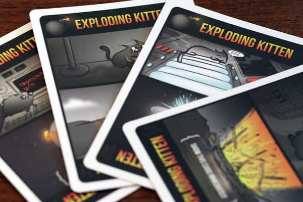 The point of the game is to avoid drawing an exploding kitten card.