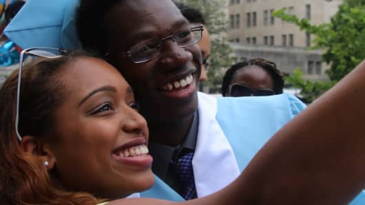 Kyare Turner at his high school graduation with Cavena Williams, a former instructor from Reach.
