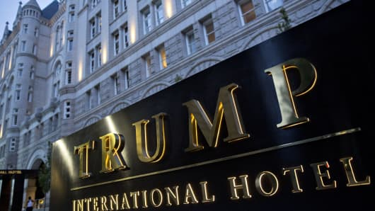 Signage stands outside the Trump International Hotel, formerly the Old Post Office Pavilion, in Washington, D.C., U.S., on Friday, Sept. 16, 2016. The hotel opened on September 12 with a formal grand opening expected in October.