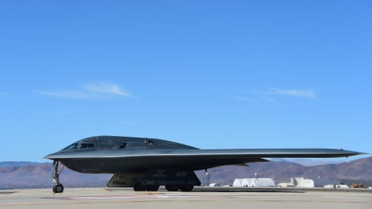 A B-2 Stealth Bomber pulls up on the runway after landing at the Palmdale Aircraft Integration Center of Excellence in Palmdale, California.