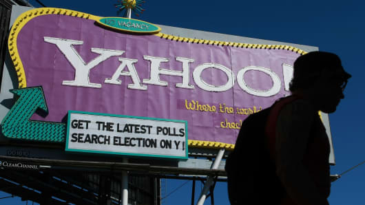 A pedestrian walks by a Yahoo billboard in San Francisco, California.