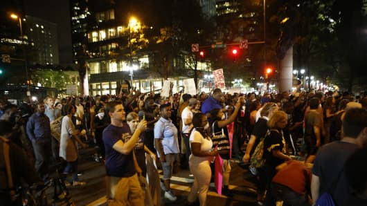 Residents and activists march in the streets amid heavy police and North Carolina National Guard presence as they protest the death of Keith Scott September 22, 2016 in Charlotte, North Carolina.
