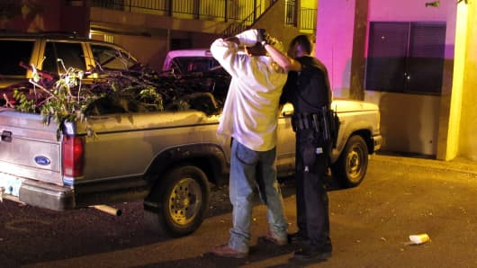 A police officer frisks a man in Albuquerque, NM.