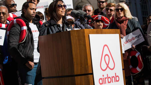 Linda Merlo, an airbnb host from the Bronx, speaks at a rally on the steps of New York City Hall showing support for the company on October 30, 2015 in New York City. The New York City council is currently debating how to regulate the controversial company.
