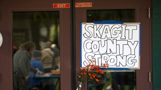 A sign displaying community strength hangs on door near community gathering at Maiben Park on September 24, 2016 in Burlington, Washington. Five people were killed last night when a gunman opened fire in the Cascade Mall.