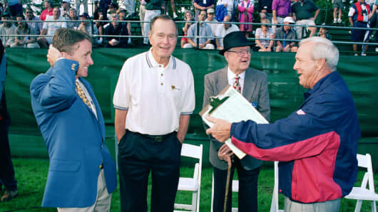Commissioner Finchem, President Bush, Byron Nelson, and US Team Captain, Arnold Palmer share a laugh during the 1996 Presidents Cup September 13-15, 1996 at Robert Trent Jones GC, Prince William County, Virginia.