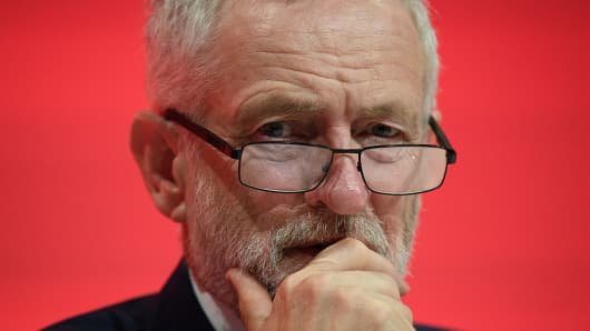 Labour Party leader Jeremy Corbyn listens to speakers on the first day of the Labour Party Conference the Exhibition Centre Liverpool on September 25, 2016 in Liverpool, England.