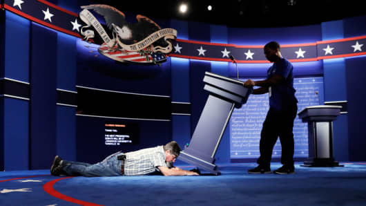 Technicians set up the stage for the presidential debate between Democratic presidential candidate Hillary Clinton and Republican presidential candidate Donald Trump at Hofstra University in Hempstead, N.Y., Sunday, Sept. 25, 2016.