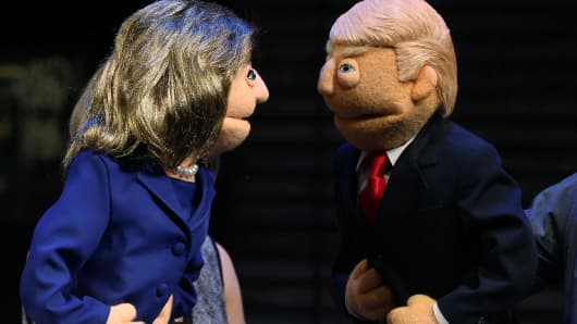 Puppets in the likeness of Democratic presidential nominee Hillary Clinton (L) and Republican presidential nominee Donald Trump (R) face-off